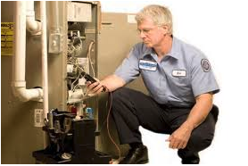 Man determining whether to repair or replace your furnace